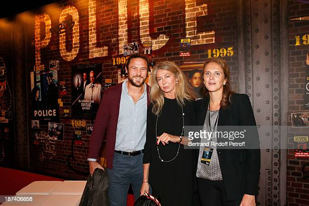 Sophie Deniau poses with her children rugbyman Vincent Deniau and police captain Marie Deniau as they attend the 100th Anniversary Of The Paris...