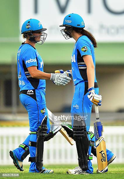 Sophie Devine is congratulated by Tahlia McGrath of the Adelaide Strikers after reaching her half century during the WBBL match between the Adelaide...