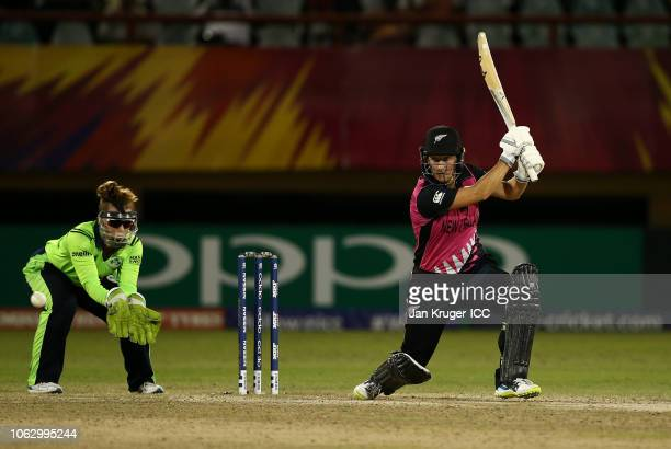 Sophie Devine of New Zealand bats with Mary Waldron wicket keeper of Ireland looking on during the ICC Women's World T20 2018 match between New...