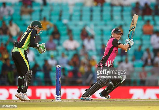 Sophie Devine of New Zealand in action with Alyssa Healy of Australia during the Women's ICC World Twenty20 India 2016 Group A match between...