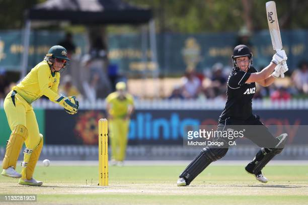 Sophie Devine of New Zealand plays a stroke past Alyssa Healy of Australia during game three of the One Day International Series between Australia...