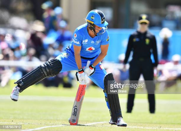 Sophie Devine of the Adelaide Strikers bats a ball between her legs during the Women's Big Bash League match between the Melbourne Stars and the...