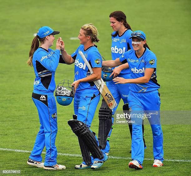 Sophie Devine of the Adelaide Strikers is congratuklated by her team mates after scoring the winning runs and reaching her century during the WBBL...