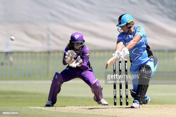 Sophie Devine of the Adelaide Strikers plays a shot during the Women's Big Bash League WBBL match between the Hurricanes and the Strikers at Gliderol...