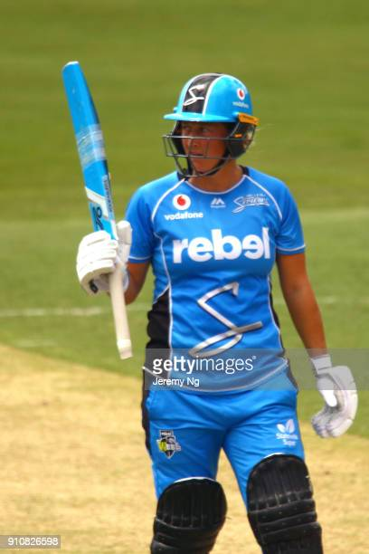 Sophie Devine of the Strikers acknowledges her half century during the Women's Big Bash League match between the Adelaide Strikers and the Sydney...
