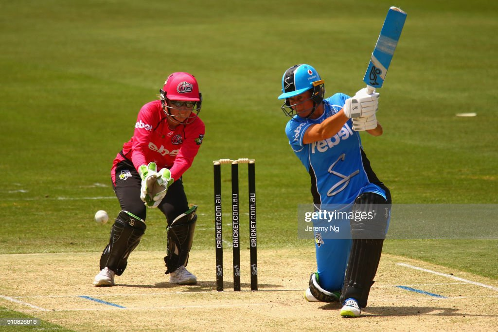 Sophie Devine of the Strikers drives the ball during the Women's Big Bash League match between the Adelaide Strikers and the Sydney Sixers at Hurstville Oval on January 27, 2018 in Sydney, Australia.