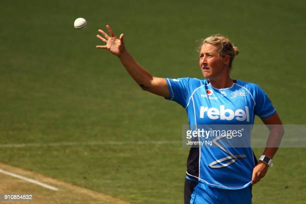 Sophie Devine of the Strikers gathers the ball during the Women's Big Bash League match between the Adelaide Strikers and the Sydney Sixers at...