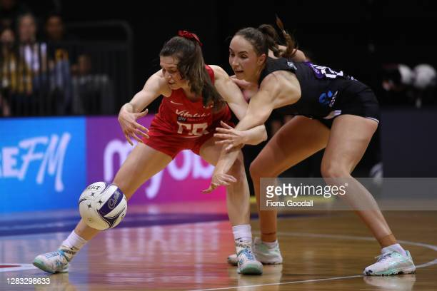 Sophie Drakeford-Lewis of England reaches for the ball under pressure from Kelly Jury of New Zealand during game 3 of the Cadbury Netball Series...