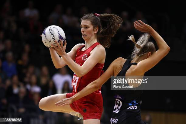 Sophie Drakeford-Lewis of England takes the ball under pressure from Jane Watson of New Zealand during game 3 of the Cadbury Netball Series between...