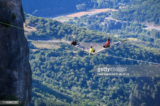 Sophie ducasse and matthias dandois in a space net on the top of a cliff, Occitanie, Florac, France on July 3, 2017 in Florac, France.