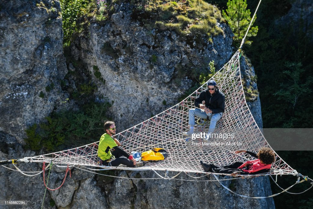 Sophie ducasse and matthias dandois in a space net on the top of a cliff, Occitanie, Florac, France... : News Photo