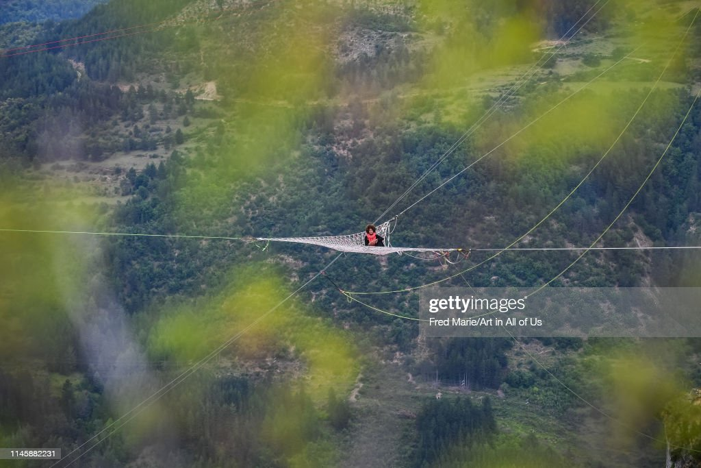 Sophie ducasse in a space net on the top of a cliff, Occitanie, Florac, France... : News Photo