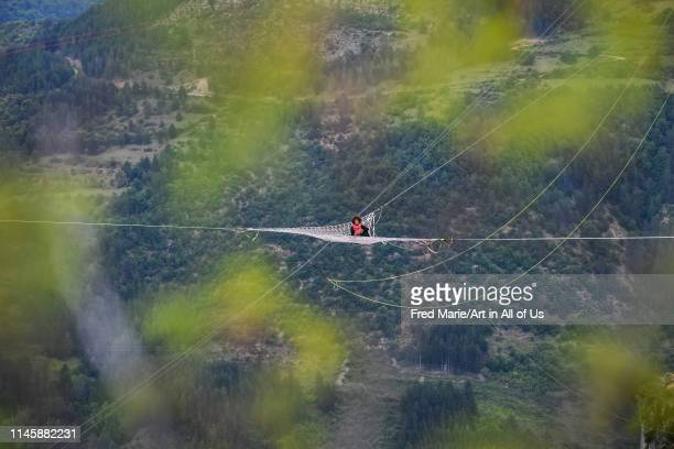 Sophie ducasse in a space net on the top of a cliff, Occitanie, Florac, France on July 2, 2017 in Florac, France.