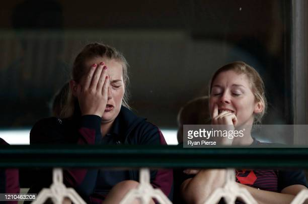 Sophie Ecclestone and Heather Knight of England look on as heavy rain falls during the ICC Women's T20 Cricket World Cup Semi Final match between...