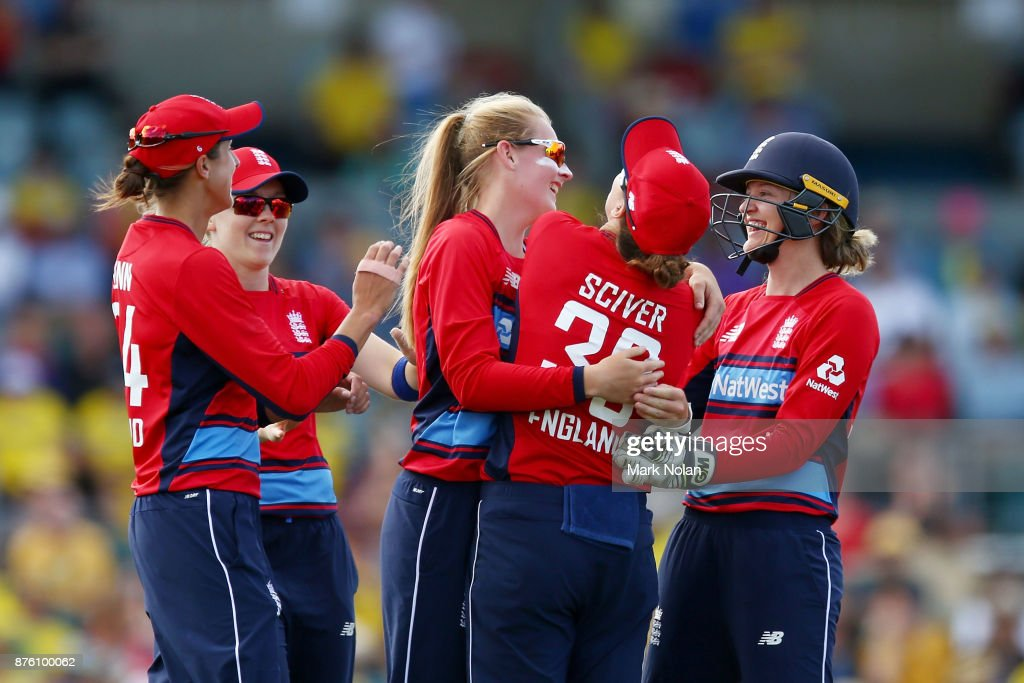 Sophie Ecclestone of England celebrates a wicket with team mates during the second Women's Twenty20 match between Australia and England at Manuka Oval on November 19, 2017 in Canberra, Australia.