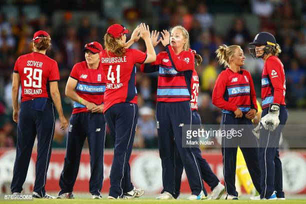 Sophie Ecclestone of England celebrates a wicket with team mates during the Third Women's Twenty20 match between Australia and England at Manuka Oval...
