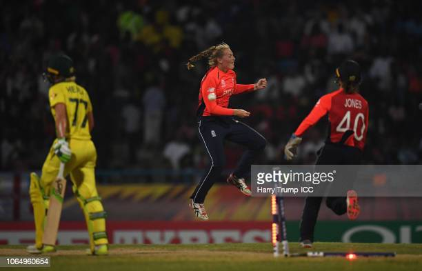 Sophie Ecclestone of England celebrates after dismissing Alyssa Healy of Australia during the ICC Women's World T20 2018 Final between Australia and...