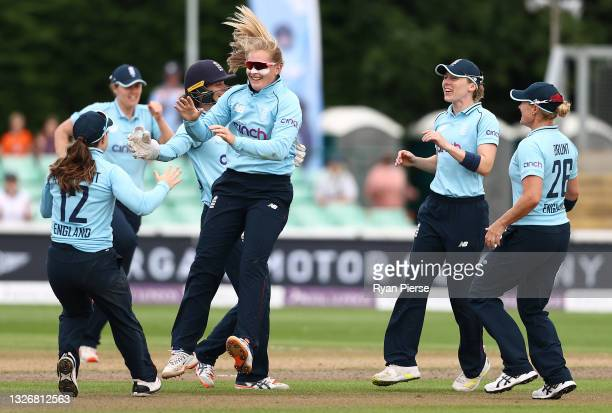 Sophie Ecclestone of England celebrates after taking the wicket of Jemimah Rodrigues of India during the 3rd Women's One Day International between...
