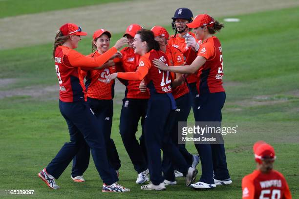 Sophie Ecclestone of England celebrates taking a catch off the bowling of Mady Villiers to dismiss Alyssa Healy of Australia during the 3rd Vitality...