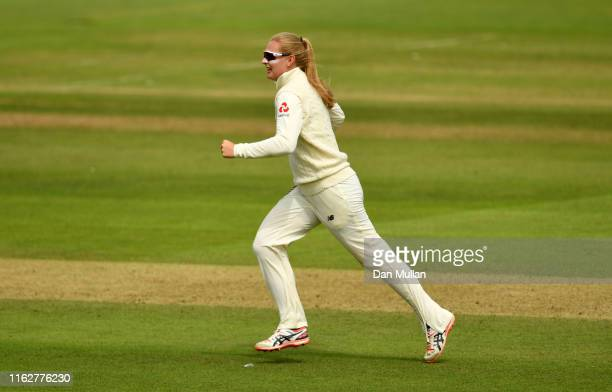 Sophie Ecclestone of England celebrates taking the wicket of Meg Lanning of Australia during the Kia Women's Test Match between England Women and...