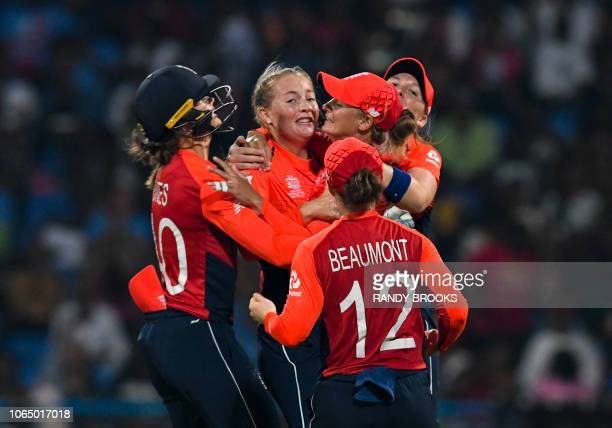 Sophie Ecclestone of England celebrates the dismissal of Alyssa Healy of Australia during the ICC Women's World T20 final cricket match between...