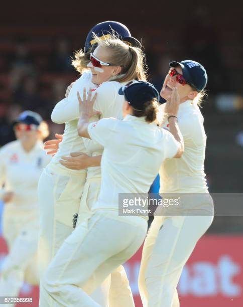 Sophie Ecclestone of England celebrates the wicket of Beth Mooney of Australia during day two of the Women's Test match between Australia and England...