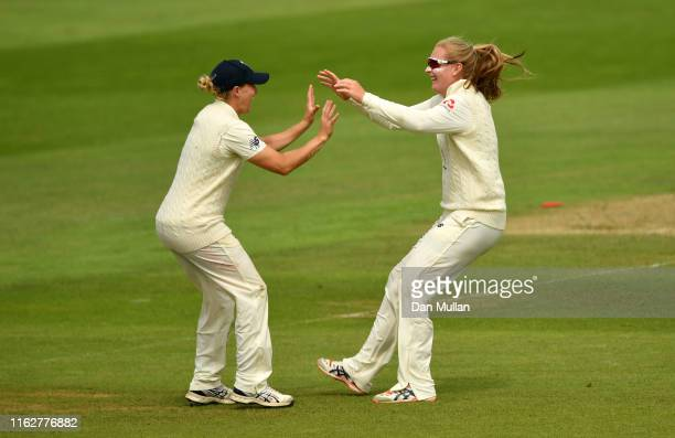 Sophie Ecclestone of England celebrates with Katherine Brunt of England after taking the wicket of Meg Lanning of Australia during the Kia Women's...