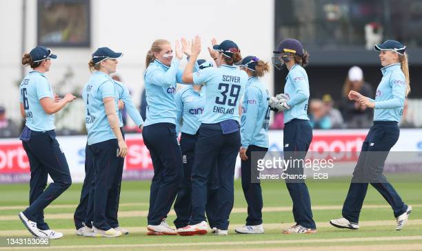 Sophie Ecclestone of England celebrates with Natalie Sciver of England after dismissing Lauren Down of New Zealand during the 5th One Day...