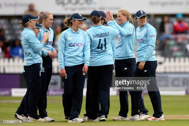 Sophie Ecclestone of England celebrates with team mates after taking the wicket of Harmanpreet Kaur of India during the women's first one day...