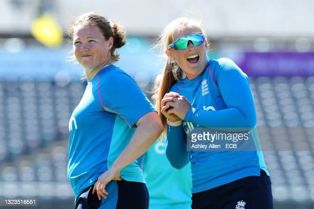 Sophie Ecclestone of England Women's team has a laugh with teammate Anya Shrubsole during an England training session at Bristol County Ground on...