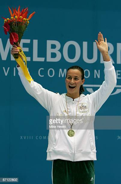 Sophie Edington of Australia poses with her gold medal after the women's 100 metres backstroke final at the Melbourne Sports Aquatic Centre during...