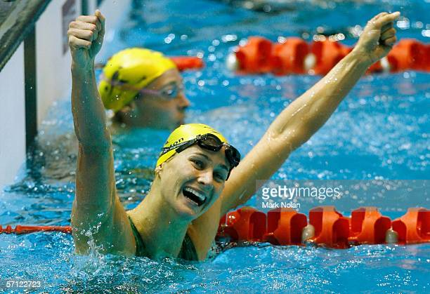 Sophie Edington of Australia reacts after she won the final of the women's 100 metres backstroke at the Melbourne Sports Aquatic Centre during day...