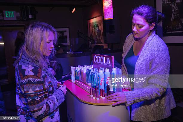 Sophie Elgort looks at Coola products in the Tone It Up Wellness Lounge during the Sundance Film Festival on January 20, 2017 in Park City, Utah.