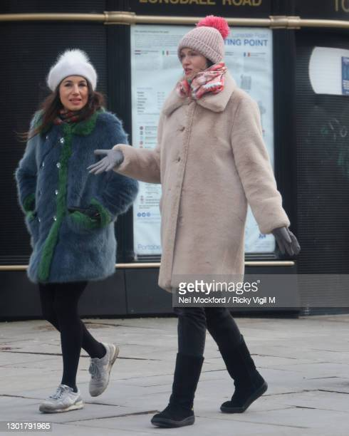 Sophie Ellis-Bextor seen with a friend walking down Portobello Road in Notting Hill on February 12, 2021 in London, England.