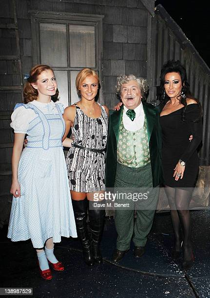 Sophie Evans Aliona Vilani Russell Grant and Nancy Dell'Olio pose backstage as Russell Grant joins the West End cast of 'The Wizard of Oz' at London...