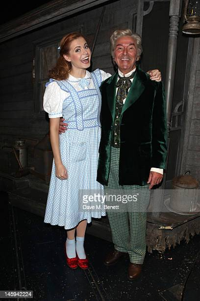 Sophie Evans and Des O'Connor pose as Dorothy and The Wizard from The Wizard of Oz at the Palladium Theatre in the West End on June 7 2012 in London...
