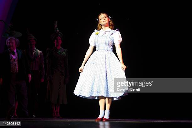 Sophie Evans appears as Dorothy at the curtain call during media night for Russell Grant in the role of the Wizard in 'The Wizard of Oz' at the...