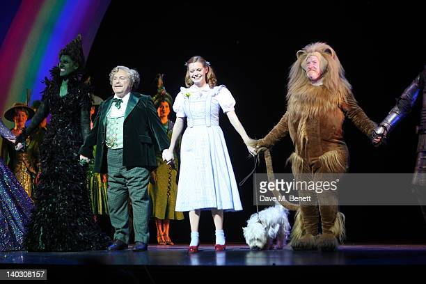 Sophie Evans appears as Dorothy with Russell Grant at the curtain call during media night for Russell Grant in the role of the Wizard in 'The Wizard...