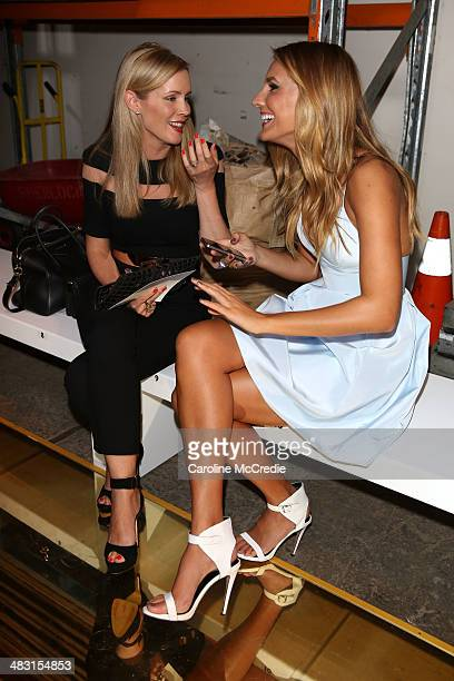 Sophie Falkiner and Laura Dundovic attend the Alex Perry show during MercedesBenz Fashion Week Australia 2014 at Carriageworks on April 7 2014 in...