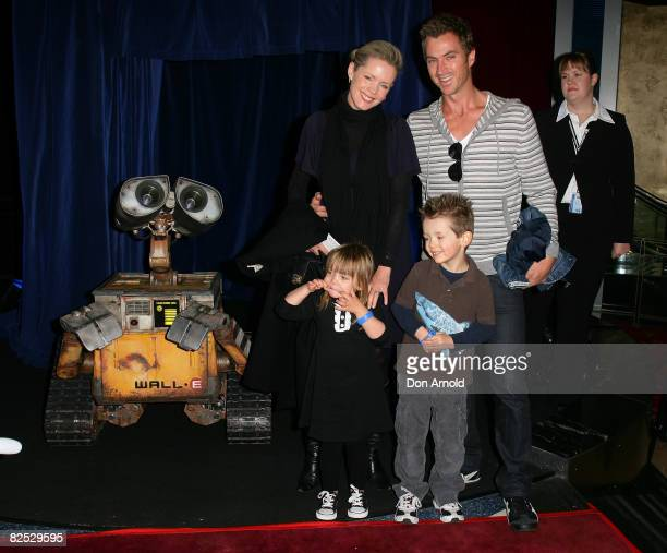 Sophie Falkiner and Tony Thomas, standing alongside their children and WALL.E, attend the Australian premiere of WALL.E at the Hoyts Cinema in the...