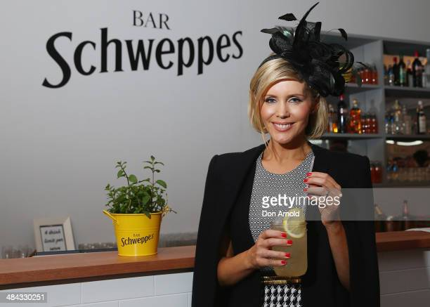 Sophie Falkiner poses inside the Schweppes Bar during the BMW Australian Derby at Royal Randwick Racecourse on April 12 2014 in Sydney Australia