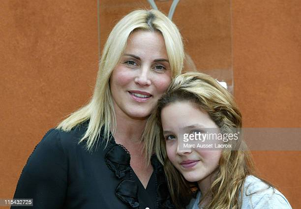 Sophie Favier and daugther CarlaMarie pose in the 'Village' the VIP area of the French Open at Roland Garros arena in Paris France on June 3 2007
