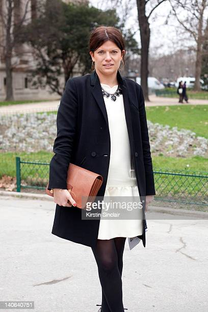 Sophie Ferguson Jones Fashion Editor at Grazia Magazine wearing Jimmy Choo shoes Victoria Beckham dress Whistles coat and Raul bag at Paris Fashion...