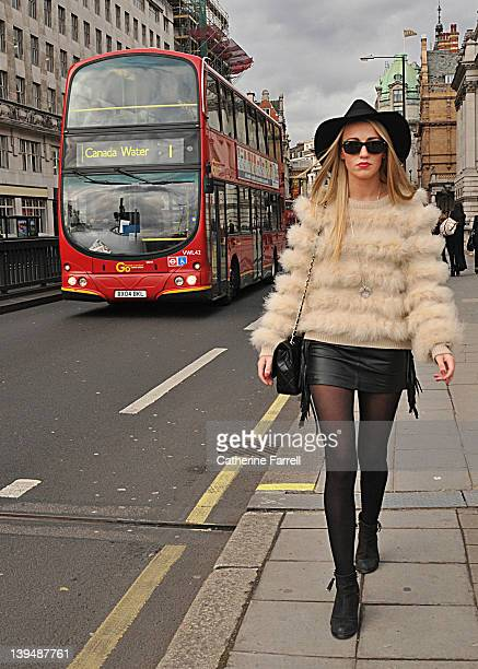 Sophie Flynn Fashion blogger wearing Top Shop sable fun fur and knit jumper Top Shop leather micro mini skirt with Fringes Top Shop Floppy Fedora hat...