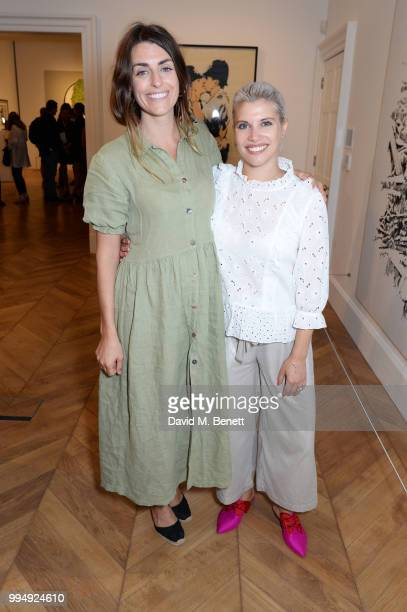 Sophie Gallagher and Pips Taylor attend the Bansky 'Greatest Hits 20022008' exhibition VIP preview at Lazinc on July 9 2018 in London England