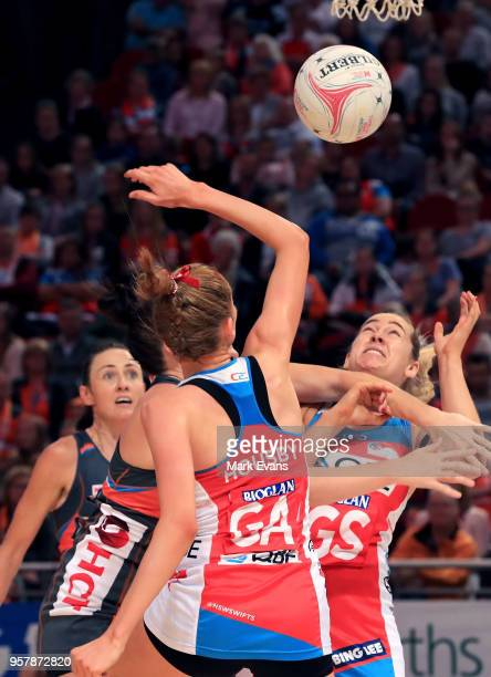 Sophie Garbin of the Swifts and Helen Housby of the Swifts compete for the ball during the round three Super Netball match between the NSW Swifts and...