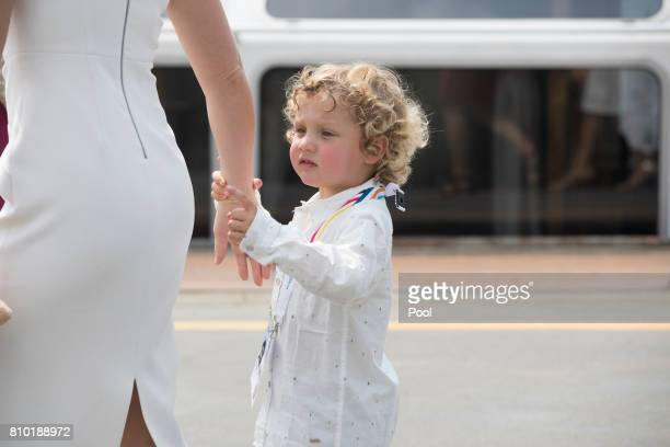 Sophie Gregoire wife of Justin Trudeau Prime Minister of Canada holds her son Hadrien's hand as they leave the boat Diplomat on the river Elbe while...
