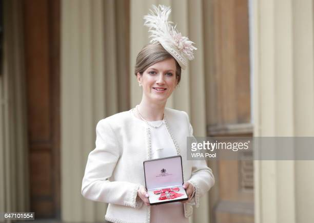 Sophie Hahn Georgina Hermitage at Buckingham Palace in London after receiving her Member of the Order of the British Empire medal from the Duke of...