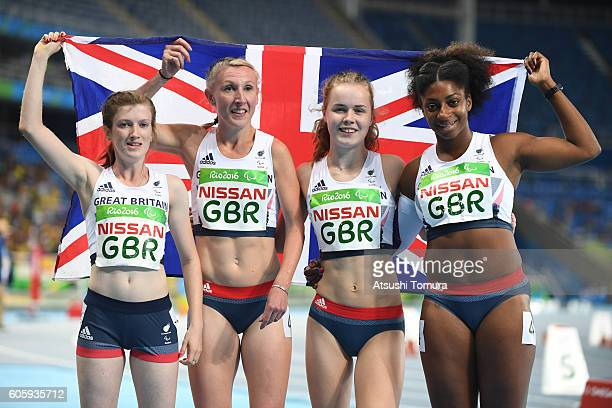 Sophie Hahn Georgina Hermitage Maria Lyle and Kadeena Cox of Great Britain pose after finishing second in the women's 4x100 meter T3538 final during...