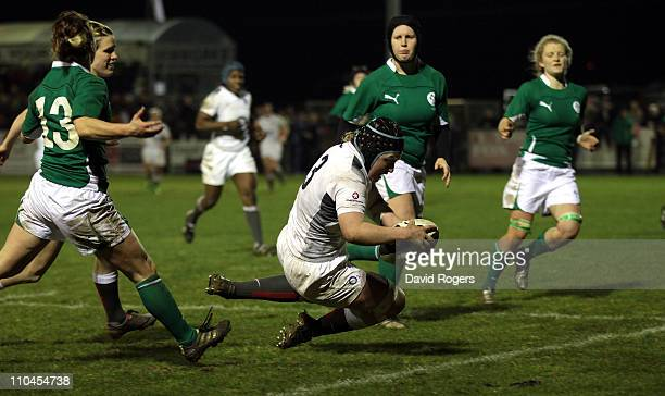 Sophie Hemming of England dives over to score a try during the Womens Six Nations match between Ireland and England at Ashbourne Rugby Club on March...